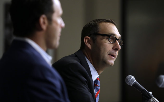 St. Louis Cardinals general manager John Mozeliak, right, and manager Mike Matheny discuss the future of Cardinals pitcher Chris Carpenter during a baseball news conference Tuesday, Feb. 5, 2013, in S