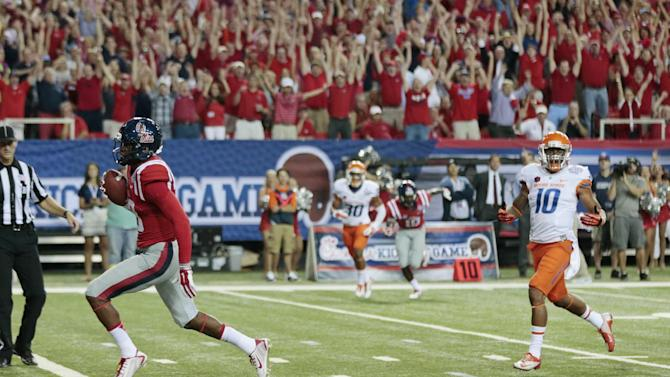 RETRANSMISSION TO CORRECT ID FROM JOHN RATLIFF TO CODY CORE - Mississippi wide receiver Cody Core (88) scores on a pass from quarterback Bo Wallace as Boise State safety Jeremy Ioane (10) gives chase in the first half of an NCAA college football game  Thursday, Aug. 28, 2014, in Atlanta