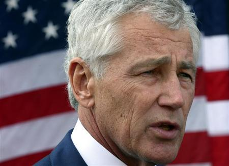 U.S. Secretary of Defense Chuck Hagel speaks to reporters at the Al Udeid Airbase, west of Doha