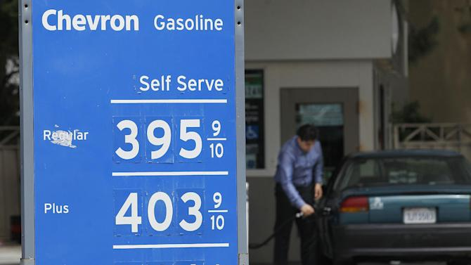 FILE - A man pumps gas at a Chevron gas station in San Francisco, in this Aug. 7, 2012 file photo. The average price of regular gasoline jumped in California from $3.86 a gallon on Tuesday to $3.94 on Thursday, according to the website GasBuddy.com. (AP Photo/Jeff Chiu, File)