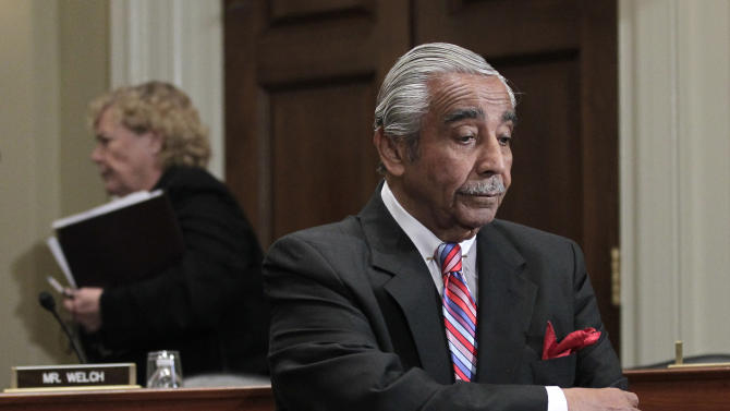 FILE - In this Nov. 15, 2010 file photo Rep. Charlie Rangel, D-NY, waits for his turn to speak before the House Committee on Standards of Official Conduct, where he faces 13 separate counts of violating House ethics rules on Capitol Hill in Washington. The 80-year-old Democrat from New York's Harlem neighborhood wants his punishment for ethics violations downgraded from censure to a reprimand, and is ready to make a last stand to salvage his reputation. Rep. Zoe Lofgren, D-Calif., chair of the Rangel Adjucatory Subcommittee, passes at left. . (AP Photo/J. Scott Applewhite, File)