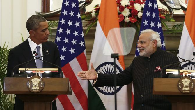Indian Prime Minister Modi reaches out to shake hands with U.S. President Obama after giving their opening statements at Hyderabad House in New Delhi