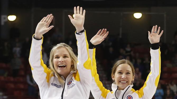 Manitoba's Jones celebrates with Lawes after they defeated Alberta in the gold medal game during the Scotties Tournament of Hearts in Moose Jaw