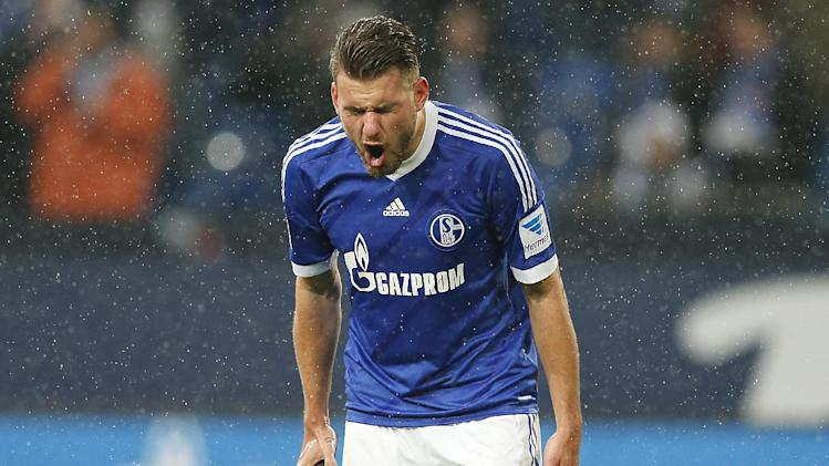 Schalke's Adam Szalai of Hungary celebrates after scoring during the German first division Bundesliga soccer match between Schalke 04 and Eintracht Braunschweig in Gelsenkirchen  , Germany, Saturday, March 22, 2014