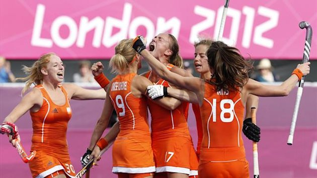 Netherlands' Maartje Paumen (C) with team mates celebrates her second goal during their women's semifinal hockey match against New Zealand at the Riverbank Arena at the London 2012 Olympic Games August 8, 2012