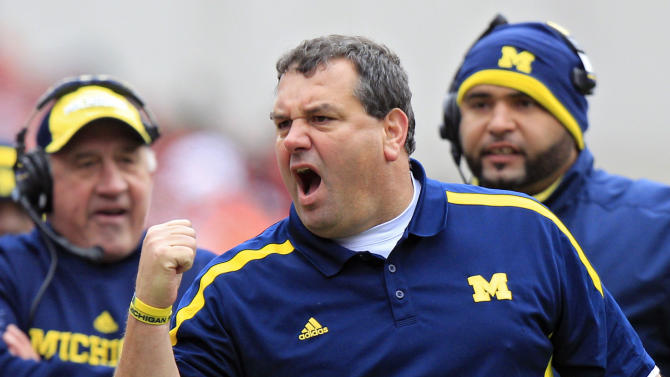 Michigan head coach Brady Hoke yells at his team in the second quarter of an NCAA college football game against Ohio State Saturday, Nov. 24, 2012, in Columbus, Ohio. (AP Photo/Jay LaPrete)