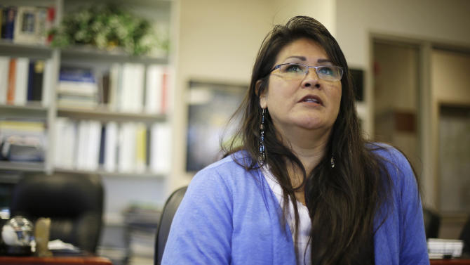 "In this photo taken Thursday, April 11, 2013 is Liz DeRouen, 49, during an interview at the Sonoma County Indian Health Project in Santa Rosa, Calif. When DeRouen needs any kind of health care services, from diabetes counseling to a dental cleaning, she checks into a government-funded clinic in Northern California's wine country that covers all her medical needs. Her care and the medical services for her children and grandchildren are paid for as part of the government's obligations to American Indian tribes dating back nearly a century. But under President Barack Obama's health care overhaul, DeRouen and tens of thousands of others who identify as Native American will face a new reality. They will have to buy their own health insurance policies or pay a $695 fine from the Internal Revenue Service unless they can prove they are ""Indian enough"" to claim one of the few exemptions allowed under the Affordable Care Act's mandate that all Americans carry insurance. (AP Photo/Eric Risberg)"