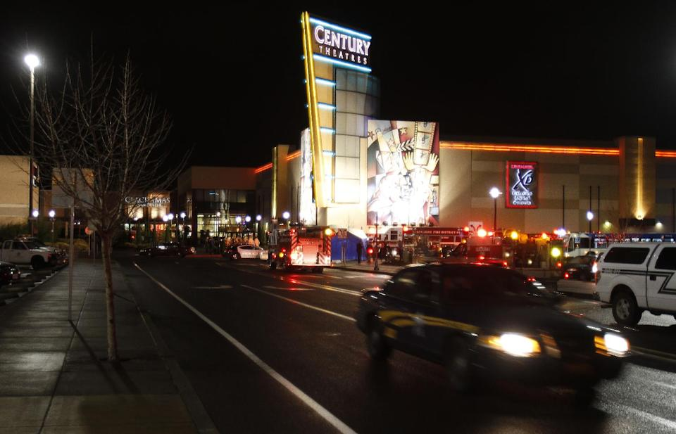 An Oregon State police car leaves the parking lot where a gunman opened fire at the Clackamas Town Center shopping mall earlier in Portland, Ore., Tuesday, Dec. 11, 2012.  Police say three people are dead, including the gunman. (AP Photo/Don Ryan)