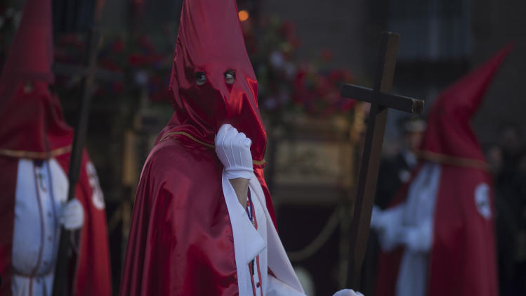 A penitent from 'Cristo de la Agonia' or 'Agony Christ' brotherhood takes part in a Holy Week procession in Alcala de Henares, Madrid, Spain, Friday, April 18, 2014. Hundreds of processions take place throughout Spain during the Easter Holy Week. (AP Photo/Gabriel Pecot)