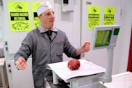 An artisan butcher works in his horsemeat butcher on February 15, 2013 in Roubaix, northern France