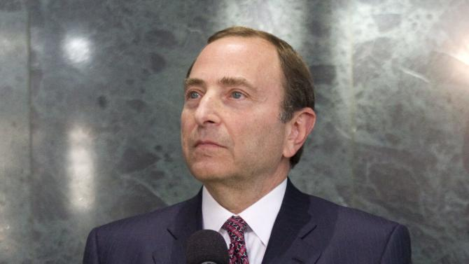 NHL commissioner Gary Bettman speaks to reporters following collective bargaining talks in Toronto on Tuesday, Oct. 16, 2012.  (AP Photo/The Canadian Press, Chris Young)