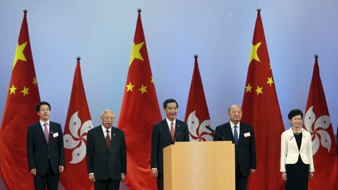 File photo of Zhang, Tung, Leung, Ma and Lam singing the national anthem during a reception in Hong Kong