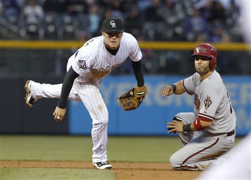 De La Rosa pitches Rockies past Diamondbacks