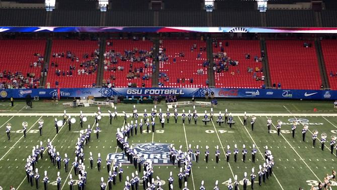 The Georgia State marching band plays before the school's football team opens its NCAA college football season against Abilene Christian, Wednesday, Aug. 27, 2014, at the Georgia Dome in Atlanta. The first season major college football's champion will be decided by a playoff began Wednesday night in a mostly empty Georgia Dome, with one of the newest members of FBS taking on a team starting its second season in DIvision I. (AP Photo/Ralph Russo)