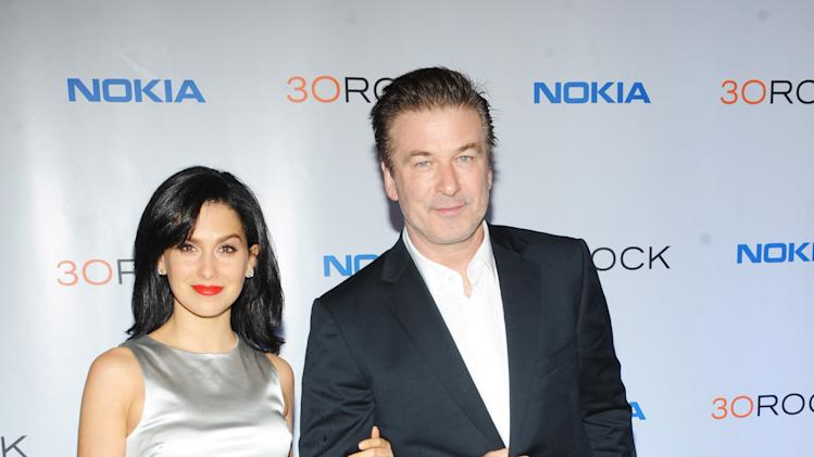 """Hilaria Thomas, left, Alec Baldwin attend the Nokia """"30 Rock"""" wrap party on Thursday, Dec. 20, 2012 in New York. (Photo by Scott Gries for Nokia/AP Images)"""