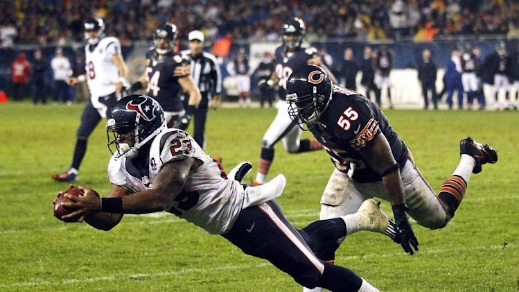Houston Texans running back Arian Foster (23) makes a touchdown catch with Chicago Bears linebacker Lance Briggs (55) defending in the first half an NFL football game in Chicago, Sunday, Nov. 11, 2012. (AP Photo/Charles Rex Arbogast)