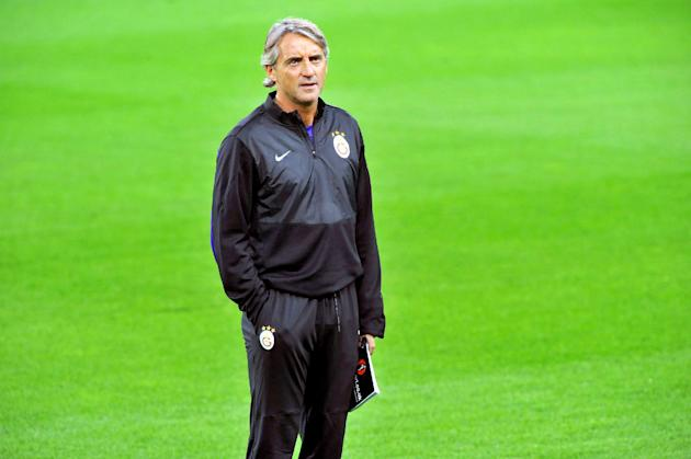 Galatasaray coach Roberto Mancini leads a training session ahead of Wednesday's Champions League, group B soccer match between Juventus and Galatasaray, at the Juventus stadium, in Turin, Italy, Tuesd