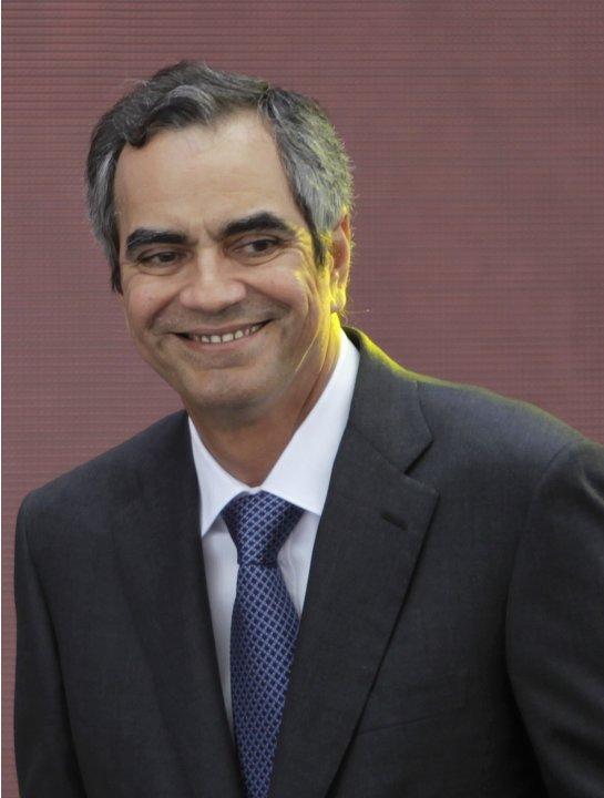 Razon, Solaire Casino-Resort owner, smiles after his speech during the opening of Solaire Casino-Resort in Pasay city, Metro Manila