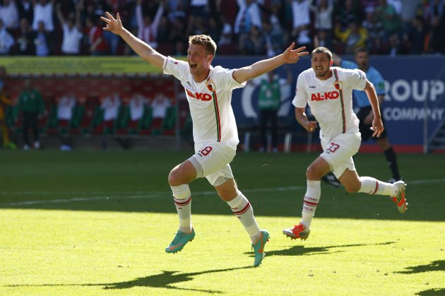 Augsburg's Callsen-Bracker and Moelders celebrate goal during German first division Bundesliga soccer match against Greuther Fuerth in Augsburg