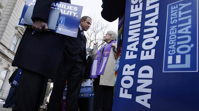 New Jersey state Sen. Raymond J. Lesniak, center, left, D-Union, co-sponsor of a bill to legalize gay marriage, listens to a supporter of the bill outside the Statehouse in Trenton, N.J., Tuesday, Jan. 24, 2012, before the Senate Judiciary Committee heard testimony on the measure. (AP Photo/Mel Evans)