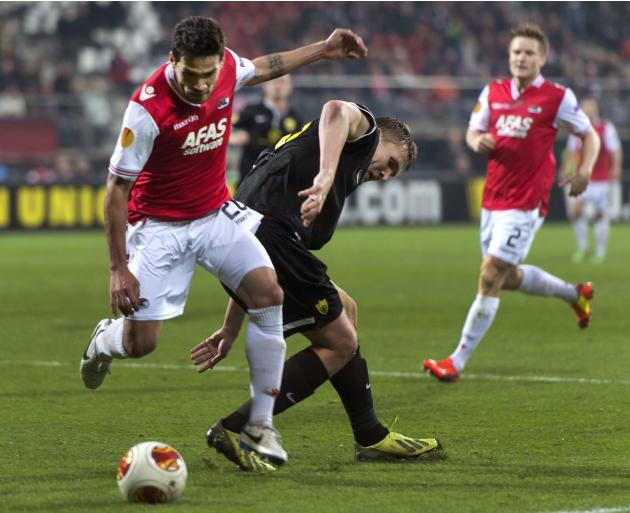 Anzhi Makhachkala's Bukharov fights for the ball with AZ Alkmaar's Ortiz during their Europa League soccer match in Alkmaar