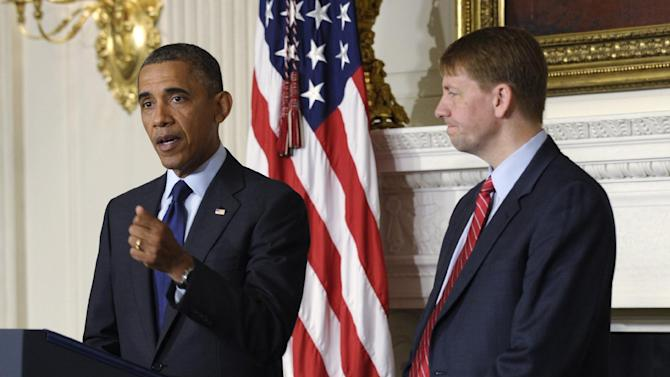 President Barack Obama, left, speaks as Richard Cordray, right, the new director of the Consumer Financial Protection Bureau, listens during a statement in the State Dining Room of the White House in Washington, Wednesday, July 17, 2013. The Senate voted on Tuesday, July 16, 2013, to end a two-year Republican blockade that was preventing Cordray from winning confirmation as director of the Consumer Financial Protection Bureau. (AP Photo/Susan Walsh)