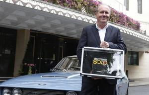 Author Boyd poses with one of the first copies of his new James Bond book Solo outside the Dorchester Hotel in London