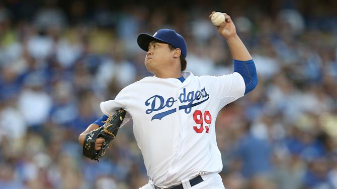 Hyun-Jin Ryuof the Los Angeles Dodgers throws a pitch at Dodger Stadium on September 6, 2014 in Los Angeles, California