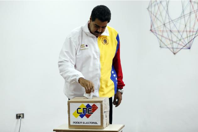 Venezuela's President Nicolas Maduro casts his ballot during municipal elections in Caracas