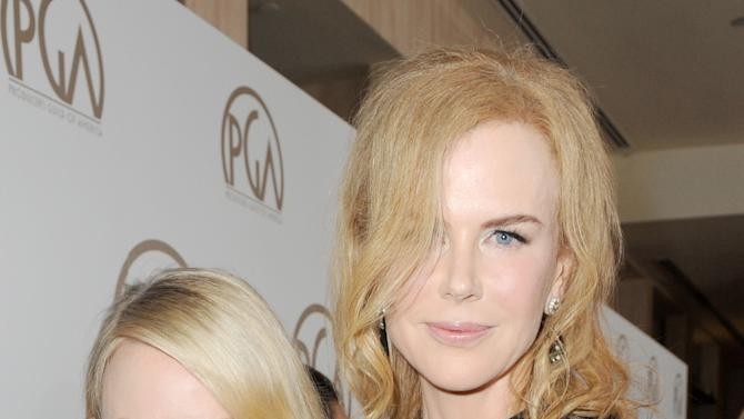 Naomi Watts, left, and Nicole Kidman arrive at the 24th Annual Producers Guild (PGA) Awards at the Beverly Hilton Hotel on Saturday Jan. 26, 2013, in Beverly Hills, Calif. (Photo by Jordan Strauss/Invision for The Producers Guild/AP Images)