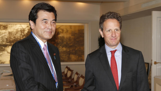 U.S. Treasury Secretary Timothy Geithner, right, and Japanese Finance Minister Koriki Jojima pose for photographers prior to their talks held on the sideline of the annual IMF/World Bank meetings in Tokyo Thursday, Oct. 11, 2012. Speaking at a financial conference Geithner said that financial reforms and other actions in response to the global crisis are yielding results, helping the U.S. economy to grow at a pace better than there was reason to expect. (AP Photo/Shizuo Kambayashi, Pool)