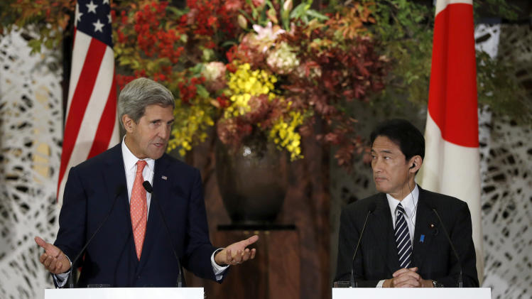 U.S. Secretary of State John Kerry, left, and Japan's Foreign Minister Fumio Kishida, right, attend their joint news conference with U.S. Secretary of Defense Chuck Hagel and Japan's Defense Minister Itsunori Onodera after the Japan-U.S. security talks in Tokyo Thursday, Oct. 3, 2013. (AP Photo/Issei Kato, Pool)