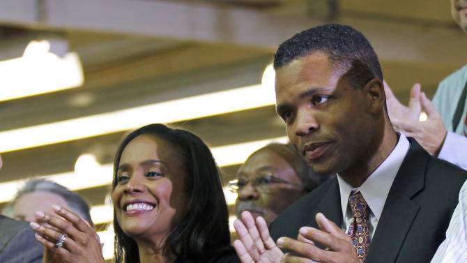 FILE - This Aug. 5, 2010 file photo shows then-Rep. Jesse Jackson Jr., D-Ill., right, and his wife, Chicago Alderman Sandi Jackson, applauding as President Barack Obama is introduced at the Ford Motor Company Chicago Assembly Plant. Sandi Jackson has resigned from the Chicago City Council. Rep. Jesse Jackson Jr. resigned from Congress in November.  (AP Photo/Pablo Martinez Monsivais, File)