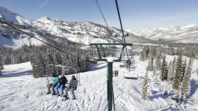 This Nov. 13, 2012 photo shows skiers riding a chair lift line at Brighton Ski Resort in the Wasatch Range, in Utah.  The Brighton Ski Resort is in middle of the Wasatch Range's 7 resorts. If the resorts were to be combined, the Utah resorts could offer North America's largest skiing complex _ three times the size of Vail and twice as big as Whistler Blackcomb in British Columbia. (AP Photo/Rick Bowmer)