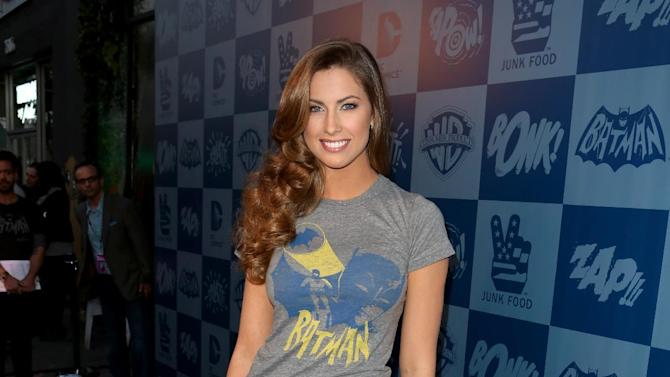 IMAGE DISTRIBUTED FOR WARNER BROS. - Katherine Webb poses on the black carpet at the launch event of Warner Bros. Consumer Products and Junk Food Clothing's Batman Classic TV Series-inspired product line at Meltdown Comics on Thursday, March 21, 2013 in Hollywood, CA. (Photo by Casey Rodgers/Invision for Warner Bros./AP Images)