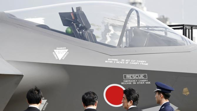 Japan's PM Abe inspects a mock-up of the F-35A during the Japan Self-Defense Force Air Review to celebrate 60 years since service's founding, in Omitama