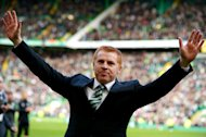 GLASGOW, SCOTLAND - APRIL 21:  Manager Neil Lennon of Celtic celebrates victory and winning the Championship after the Clydesdale Bank Scottish Premier League match between Celtic and Inverness Caledonian Thistle at Celtic Park Stadium on April 21, 2013 in Glasgow, Scotland. (Photo by Jeff J Mitchell/Getty Images)