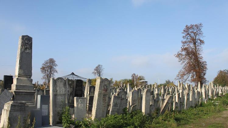 In this photo taken on Oct. 22 2012, the Jewish cemetery, one of the largest in eastern Europe, is seen in Chernivtsi, a city of 250,000  in southwestern Ukraine. Known as the Little Paris or, alternatively, the Little Vienna of Ukraine, Chernivtsi is a perfect place for a quiet romantic weekend trip and a crash course in the painful history of Europe in the 20th century. (AP Photo/Maria Danilova)