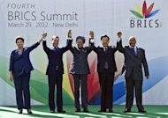 Heads of the BRICS countries pose prior to the BRICS summit in New Delhi, March 2012. China and other BRICS emerging economies are set to flex their muscles as the top finance officials of the G20 and the IMF meet seeking to raise $400 billion to prevent financial contagion