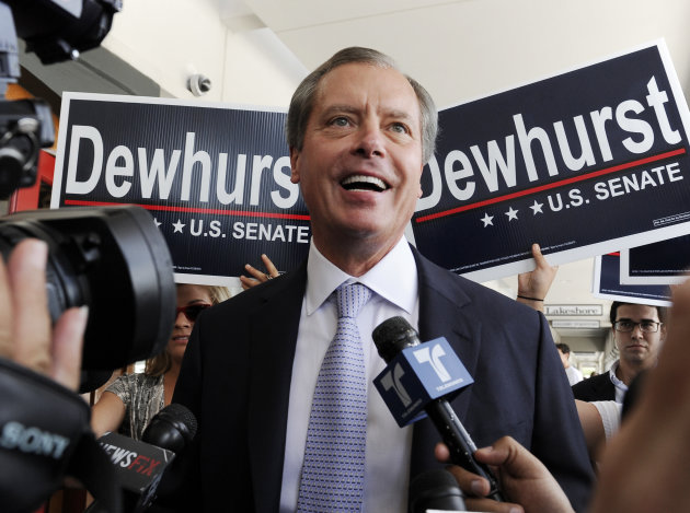 Texas Lt. Gov. David Dewhurst is backed by supporters outside a Houston deli as he answers reporters questions Tuesday, July 31, 2012. Dewhurst faces former Texas Solicitor General Ted Cruz in the Republican primary runoff election for U.S. Senator. (AP Photo/Pat Sullivan)