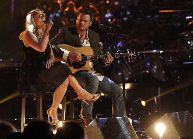 "This May 21, 2013 photo released by NBC shows married singers Miranda Lambert, left, and  Blake Shelton performing an acoustic version of the hit ""Over You"" during a broadcast of the singing competiti"
