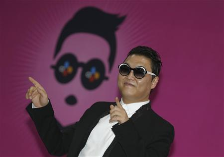 Reuters/Reuters - South Korean rapper Psy poses during a news conference before his concert in Seoul April 13, 2013.