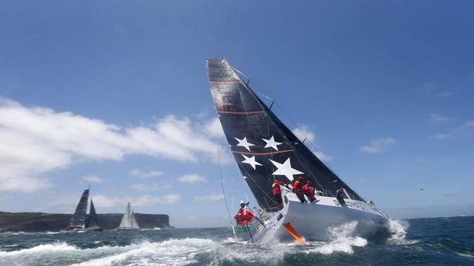 New Zealand boat Giacomo heads into the Pacific Ocean at the start of the Sydney to Hobart Yacht Race