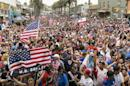 U.S. soccer fans react as they watch the telecast of the 2014 Brazil World Cup match between the United States and Germany in Hermosa Beach, Calif., Thursday, June 26, 2014. Germany won 1-0. (AP Photo/Damian Dovarganes)