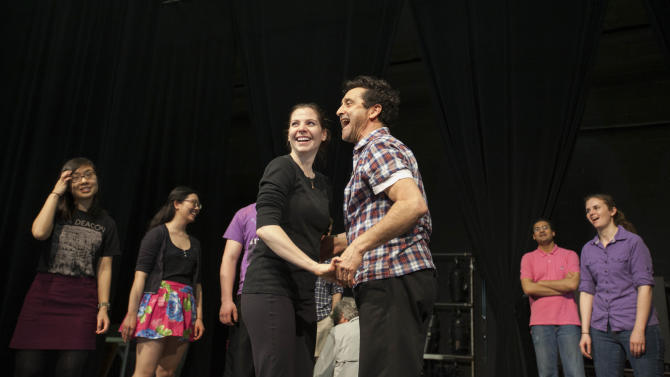 In this April 29, 2013, photo, Billy Siegenfeld, Northwestern University Professor of Dance, center right, and dance instructor Jordan Kahl demonstrate swing dance steps for engineering students, in Evanston, Ill. The students are learning to swing dance in a for-credit class called Whole Body Thinking. They say the class is teaching them to think on their feet and work collaboratively with dance partners _ skills they say will help make them better engineers. (AP Photo/Teresa Crawford)