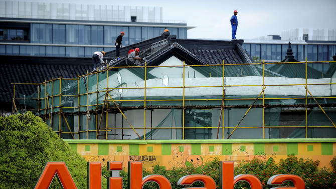 In this Monday, Sept. 15, 2014 photo, workers renovate an ancient-style building at the headquarters of Alibaba Group in Hangzhou in east China's Zhejiang province. Alibaba Group's U.S. stock offering is a wakeup call about an emerging wave of technology giants in China's state-dominated economy. (AP Photo) CHINA OUT