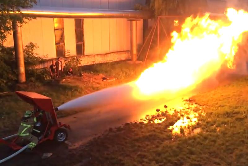 Firefighter fights flamethrower with firehose, raises questions