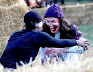 A runner competes in a zombie-infested obstacle course.