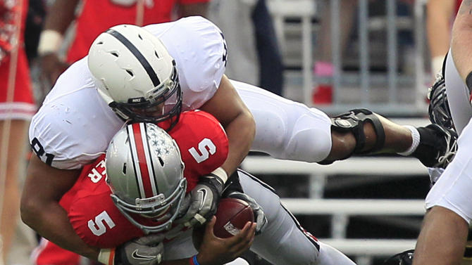 Ohio State quarterback Braxton Miller (5) is sacked by Penn State defensive end Jack Crawford in the first half of an NCAA college football game on Saturday, Nov. 19, 2011, in Columbus, Ohio. (AP Photo/Al Behrman)
