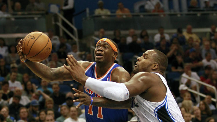 New York Knicks' Ronnie Brewer (11) drives to the basket past Orlando Magic's Glen Davis, right, during the first half of an NBA basketball game, Tuesday, Nov. 13, 2012, in Orlando, Fla. (AP Photo/John Raoux)